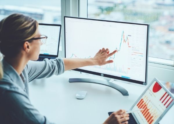 woman looking at data and graphs